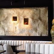 At Tokyo Bay restaurant a faux stone wall interior design, room, wall, black, white