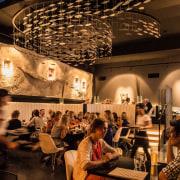 Tokyo Bay restaurant has tiered dining areas and café, interior design, restaurant, black, brown, orange