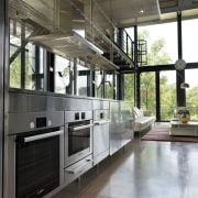 Much of the interior of this home was architecture, countertop, interior design, kitchen, gray, black
