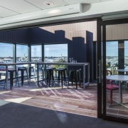 On this fit-out, an upper-level outdoor area is door, interior design, property, real estate, window, gray