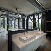 This double basin vanity is cantilevered off the architecture, countertop, daylighting, house, interior design, black, gray