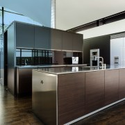 A strong, simple cube form with reflective surfaces cabinetry, countertop, floor, furniture, interior design, kitchen, black, white