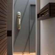 To add extra space in this bathroom design door, interior design, lighting, gray, black