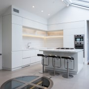 Clean lines, white cabinetry, and a high ceiling architecture, ceiling, countertop, floor, interior design, kitchen, product design, gray