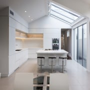 Clean, white and light, this kitchen by designer architecture, daylighting, floor, interior design, kitchen, product design, real estate, gray
