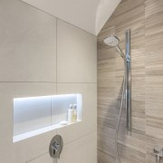 Simple touches like internally lit wall niches both angle, bathroom, floor, interior design, plumbing fixture, product design, tap, tile, wall, gray