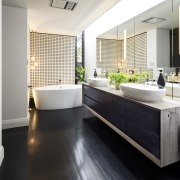 A wall of mirror visually doubles the size bathroom, countertop, floor, flooring, interior design, kitchen, room, white, black