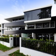 These new apartments at 305 Tamaki Drive, Kohimarama architecture, building, condominium, corporate headquarters, elevation, facade, home, house, mixed use, property, real estate, residential area, black, white