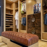 While providing a wide variety of storage options, furniture, interior design, wood, orange, brown