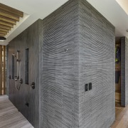 The wall in this spacious two-person shower is architecture, ceiling, floor, flooring, interior design, lobby, real estate, wall, wood, wood flooring, gray