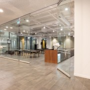 A frameless glass moveable visual separation for the ceiling, floor, flooring, interior design, lobby, gray