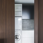 In this kitchen designed by Minosa, additional storage cabinetry, cupboard, product design, gray, black