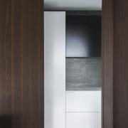 In this kitchen designed by Minosa, additional storage cabinetry, cupboard, furniture, interior design, wardrobe, black, gray