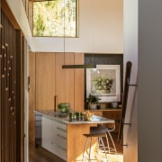 In this kitchen by architect Megan Edwards, the architecture, ceiling, daylighting, furniture, hardwood, home, house, interior design, wood, brown, orange