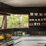 A frameless corner window helps this kitchen niche cabinetry, countertop, interior design, kitchen, under cabinet lighting, black