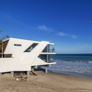 Architect Mark Dziewulski designed an angled structure that architecture, beach, coast, coastal and oceanic landforms, horizon, house, ocean, property, real estate, sea, shore, sky, tourism, vacation, blue