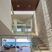 Three large skylights above the entranceway of this apartment, architecture, ceiling, condominium, daylighting, estate, floor, handrail, hardwood, house, interior design, lobby, real estate, stairs, wood, gray