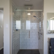 The well-equipped shower in this bathroom features a architecture, bathroom, ceiling, daylighting, floor, flooring, glass, home, house, interior design, plumbing fixture, real estate, room, tile, wall, gray