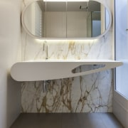 In this design, a richly veined marble feature architecture, bathroom, bathroom accessory, bathroom cabinet, floor, furniture, interior design, product, product design, shelf, sink, tap, tile, wall, gray, white