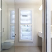 Adjustable shutters optimise light and privacy by turn. bathroom, bathroom accessory, bathroom cabinet, home, interior design, room, window, white, gray