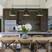 Distressed mismatched oak veneer cabinetry in this kitchen countertop, dining room, furniture, home, interior design, kitchen, room, table, gray, black