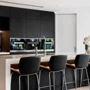 Two black, glass and stainless steel ovens flank furniture, interior design, kitchen, table, black, white