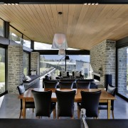 Large, operable clerestory windows at the rear of architecture, house, interior design, real estate, gray, black