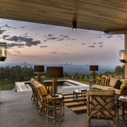 This high-end farmhouse offers several outdoor living areas, home, house, interior design, outdoor structure, patio, real estate, table, brown, gray