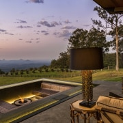 A firepit provides an outdoor feature for this architecture, estate, home, house, landscape, property, real estate, sky, tree, brown