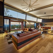 This high-ceilinged living space features giant framed window architecture, ceiling, daylighting, estate, flooring, hardwood, house, interior design, living room, real estate, wood, wood flooring, brown, orange