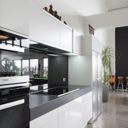 The concealed ventilation unit and almost flush hob architecture, countertop, interior design, kitchen, real estate, gray, black