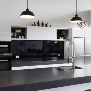This kitchen in a warehouse conversion presents as countertop, furniture, interior design, kitchen, product design, white, black