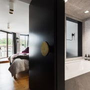 The conversion of this wharf building into apartments architecture, bathroom, ceiling, home, house, interior design, room, white, black