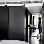 A black sliding wall panel can close down floor, furniture, interior design, room, black, white