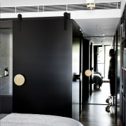This black sliding wall panel can open up floor, furniture, interior design, room, black, white