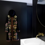 The innermost section of this suite contains the bathroom, interior design, product design, room, black, white