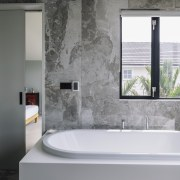 A seamless tub surround makes light work of bathroom, bathtub, floor, glass, interior design, plumbing fixture, tap, gray