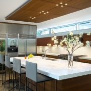 At one end of this kitchen, a bank ceiling, countertop, house, interior design, kitchen, real estate, brown, white