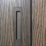 The design of Chants Off-Flush Pull was tweaked wood, wood stain, gray