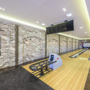 A full-size bowling alley is just one of ceiling, floor, flooring, interior design, leisure centre, lobby, real estate, gray