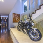 This home includes several unusual features for a house, interior design, motorcycle, vehicle, gray