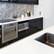 The tiles for this splashback were sourced in countertop, interior design, kitchen, product design, room, sink, white, black