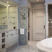 The intricately worked cabinetry in this master bathroom bathroom, bathroom accessory, bathroom cabinet, floor, home, interior design, room, gray