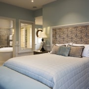 Traditional mouldings frame a wall opening and internal bed, bed frame, bed sheet, bedroom, ceiling, estate, floor, home, interior design, mattress, real estate, room, suite, wall, window, gray