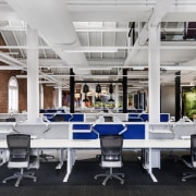 White-painted exposed services on the workfloor add to furniture, interior design, office, table, gray