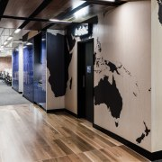 On the workfloor of Lonely Planets new offices, exhibition, floor, flooring, interior design, gray, black