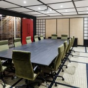 One side of this boardroom looks out over conference hall, furniture, interior design, table, gray