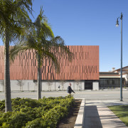 Copper-coloured concrete forms reminiscent of envelopes clad the architecture, building, campus, corporate headquarters, daytime, facade, neighbourhood, plaza, real estate, sky, teal