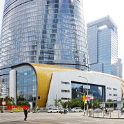 The Shanghai Towers six-storey retail podium is a architecture, building, city, commercial building, condominium, corporate headquarters, daytime, downtown, metropolis, metropolitan area, mixed use, neighbourhood, plaza, real estate, shopping mall, skyscraper, tower block, urban area, white