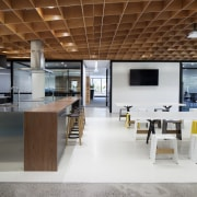 The Social Kitchen and casual meeting tables form ceiling, floor, flooring, furniture, interior design, table, gray, brown